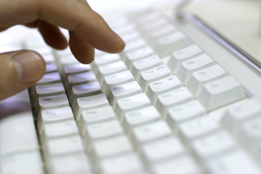 Hand typing at a keyboard