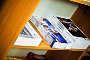 Research journals on a shelf